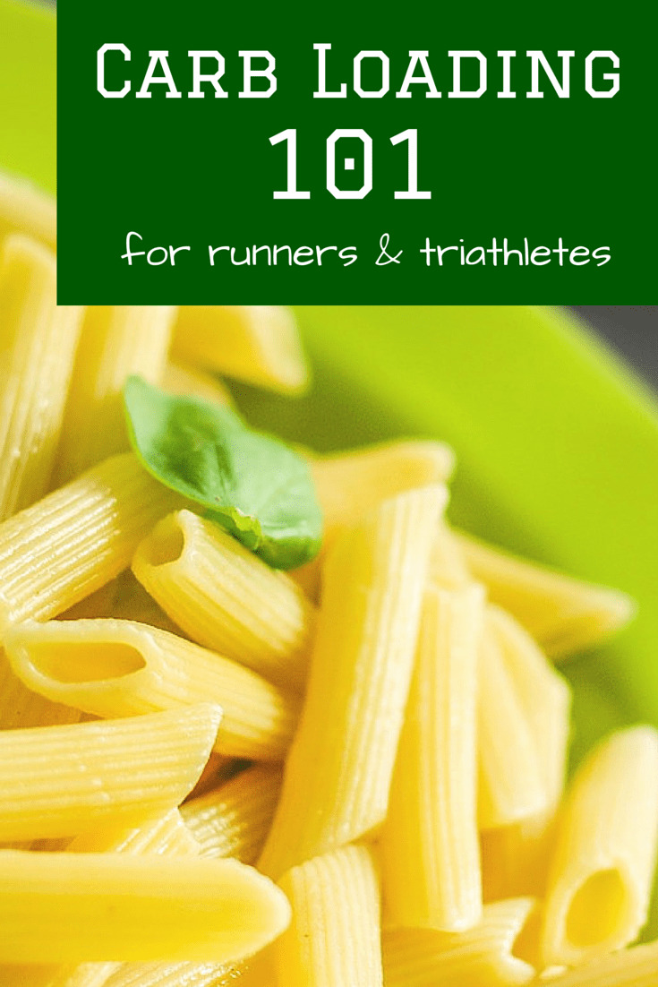 a bowl of pasta with a text overlay about carb loading for runners