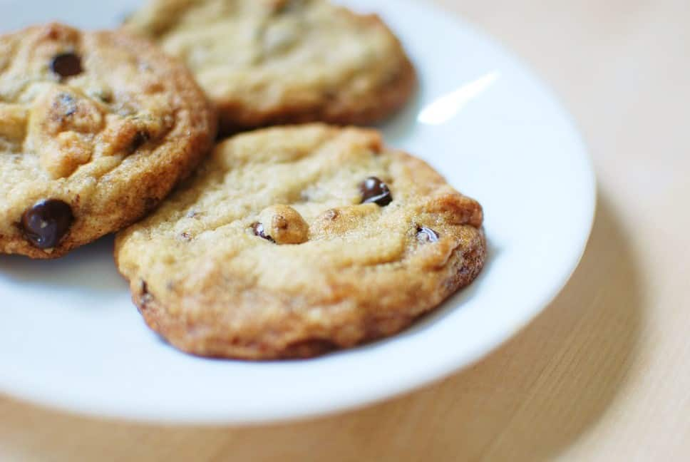 Vegan chocolate chip cookies on a plate that are dairy free and egg free