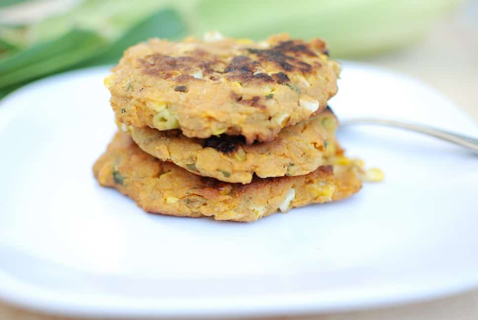 Close up of 3 vegan corn fritters on a plate