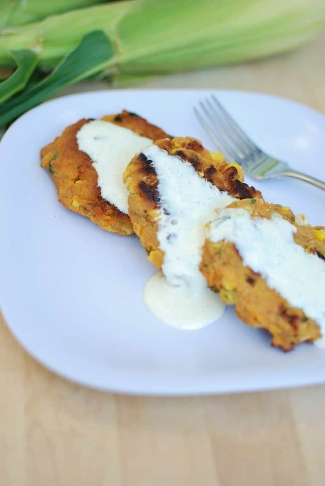 Corn and Sweet Potato Fritters with aquafaba ailoi on a plate