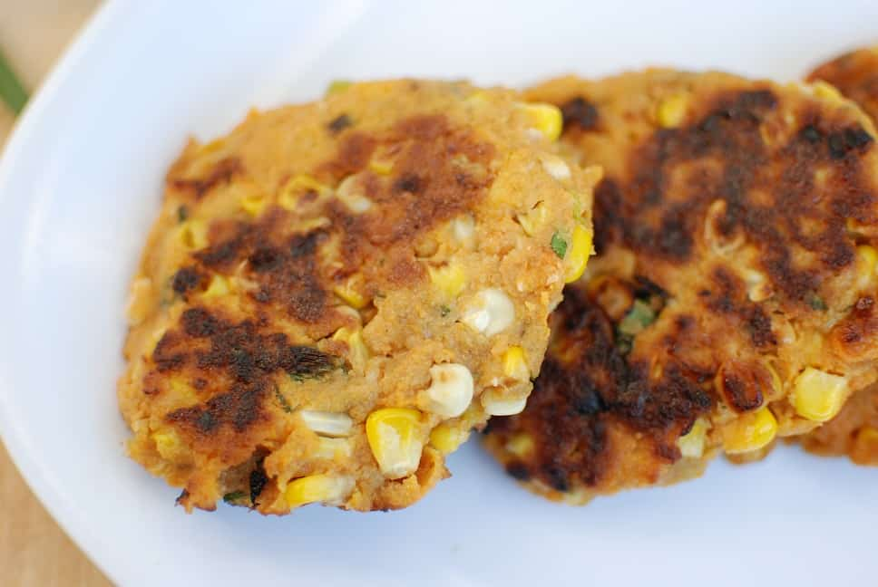 Vegan corn fritters on a white plate