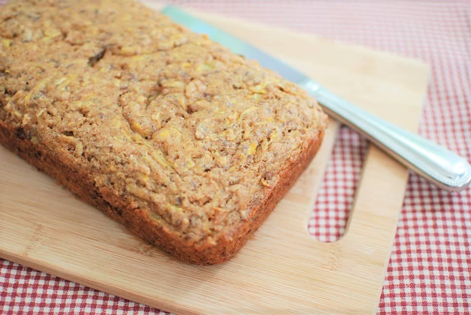 A loaf of summer squash bread on a cutting board