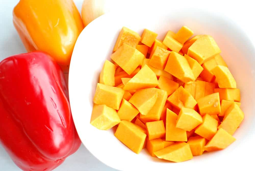 Peeled and chopped butternut squash in a bowl.