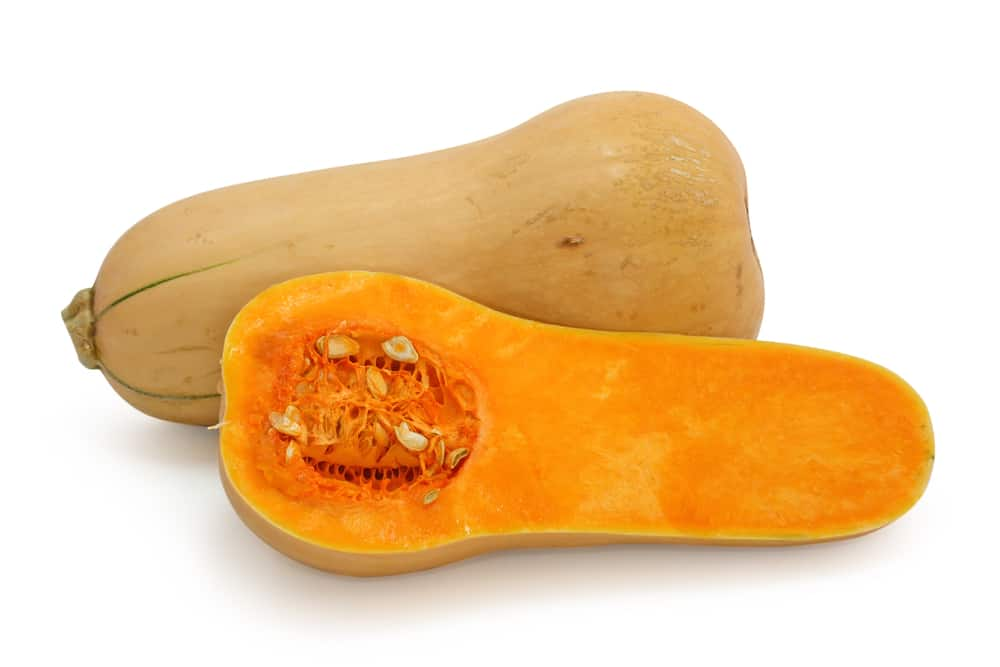 A butternut squash that's been chopped in half.