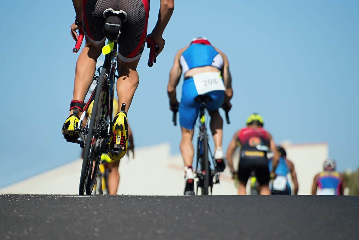 Cyclists on the road during a triathlon race.