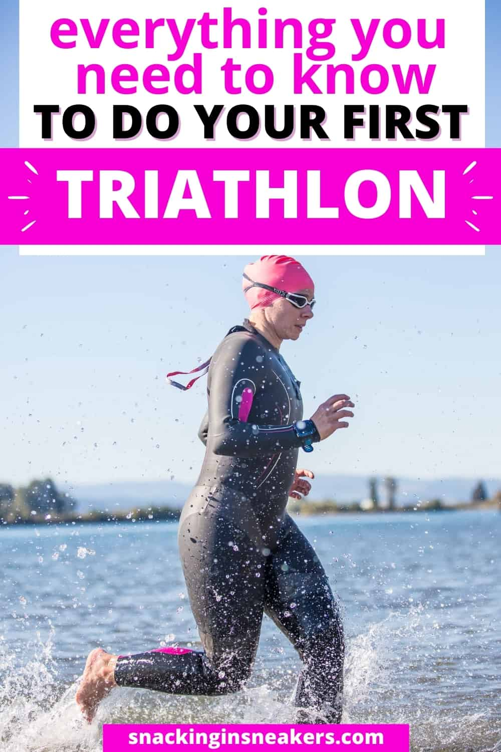 A woman in a wetsuit running into the water to do her first triathlon.