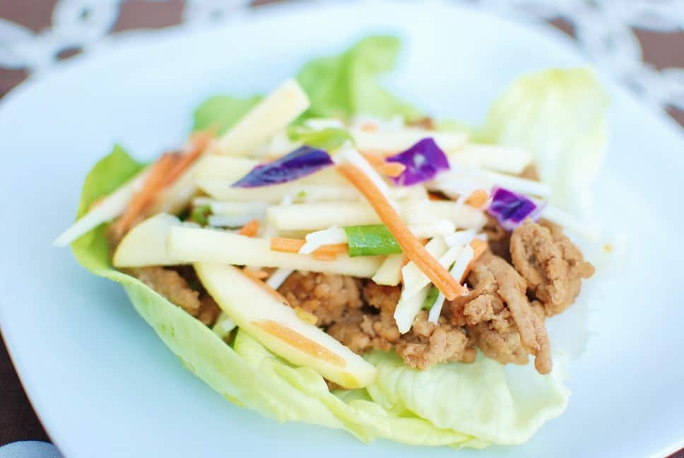 Thai Lettuce Wraps made with ground turkey and topped with a cabbage apple slaw.