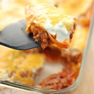 Texas lasagna is a southwestern style casserole recipe – flavors like chili powder and paprika are used to season the meat, corn tortillas take the place of lasagna noodles, and cheddar replaces mozzarella. This healthy version is under 500 calories per serving yet still tastes rich and indulgent!