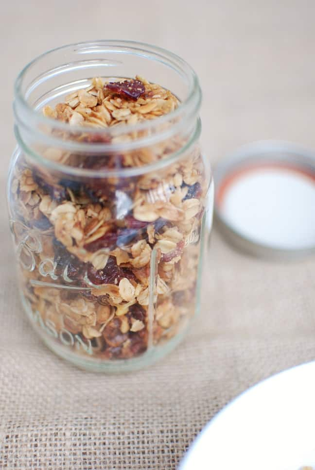 Want homemade granola that tastes delicious and is easy to make? Try this healthy 7 ingredient crockpot granola recipe! So simple to make in the slow cooker.