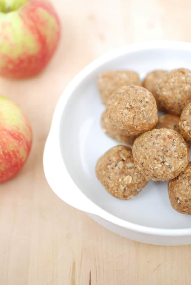 These no bake apple peanut butter energy bites are a great snack for adults and kids alike. This family friendly recipe takes just a few minutes to make in the food processor and can be stored in the fridge for easy snacking throughout the week.