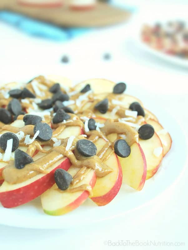 Apple nachos make amazing better-for-you game day grub! Treat the football lovers in your life to this healthier snack.