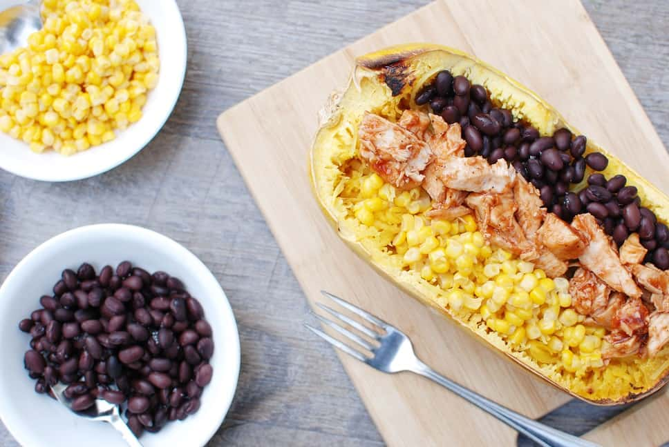 These BBQ chicken spaghetti squash bowls are a perfect way to combine your love of BBQ with a veggie rich dish. With less than 10 ingredients and only 500 calories per serving, it's a healthy dish that's easy to make!