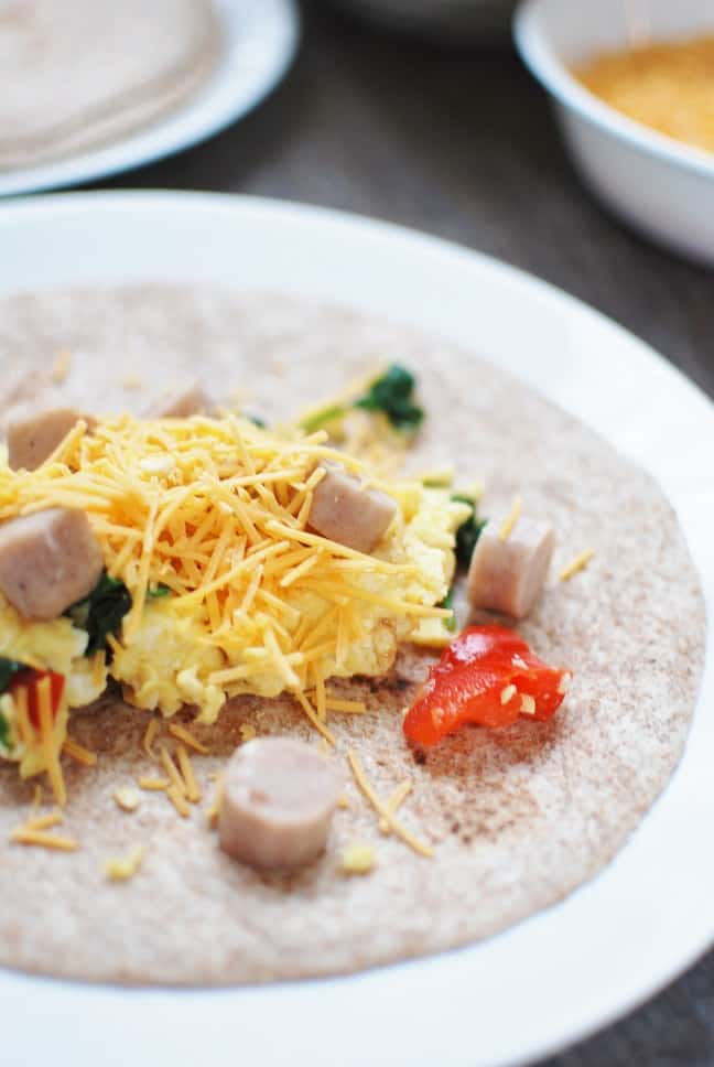 Looking for a healthy breakfast for meal prep? These make ahead breakfast burritos are just what you need! Healthy and filling, this freezer meal includes veggies for vitamins and minerals as well as eggs and chicken sausage to pack in protein.