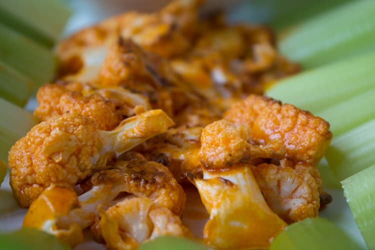 "Buffalo cauliflower ""wings"" make amazing better-for-you game day grub! Treat the football lovers in your life to this healthier snack."