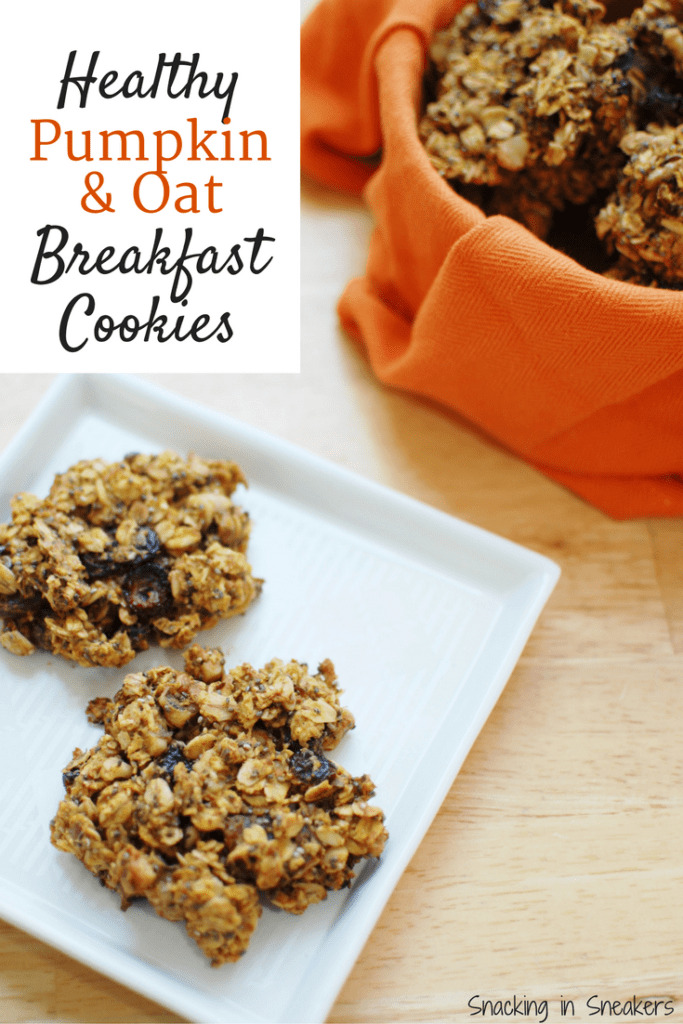 two breakfast cookies on a white plate next to a basket full of cookies