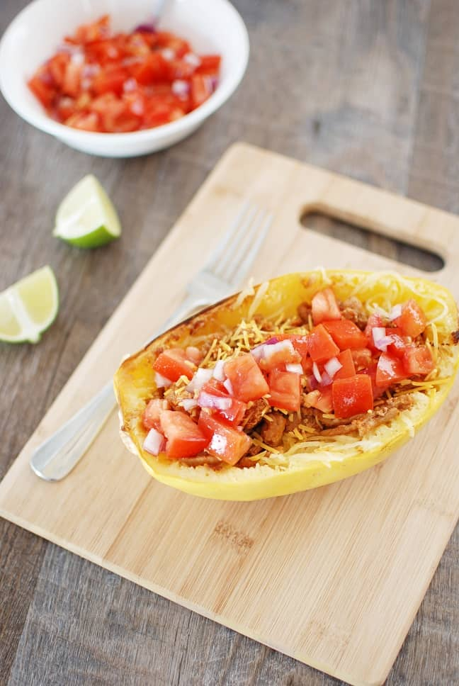 Spaghetti squash taco boats are tasty, nutritious, and perfect for a family dinner! Instead of using shells for your tacos, you simply add the meat and homemade salsa on top of roasted spaghetti squash. And at under 400 calories each, it's a filling meal you can feel good about eating! Gluten free and dairy free options available.