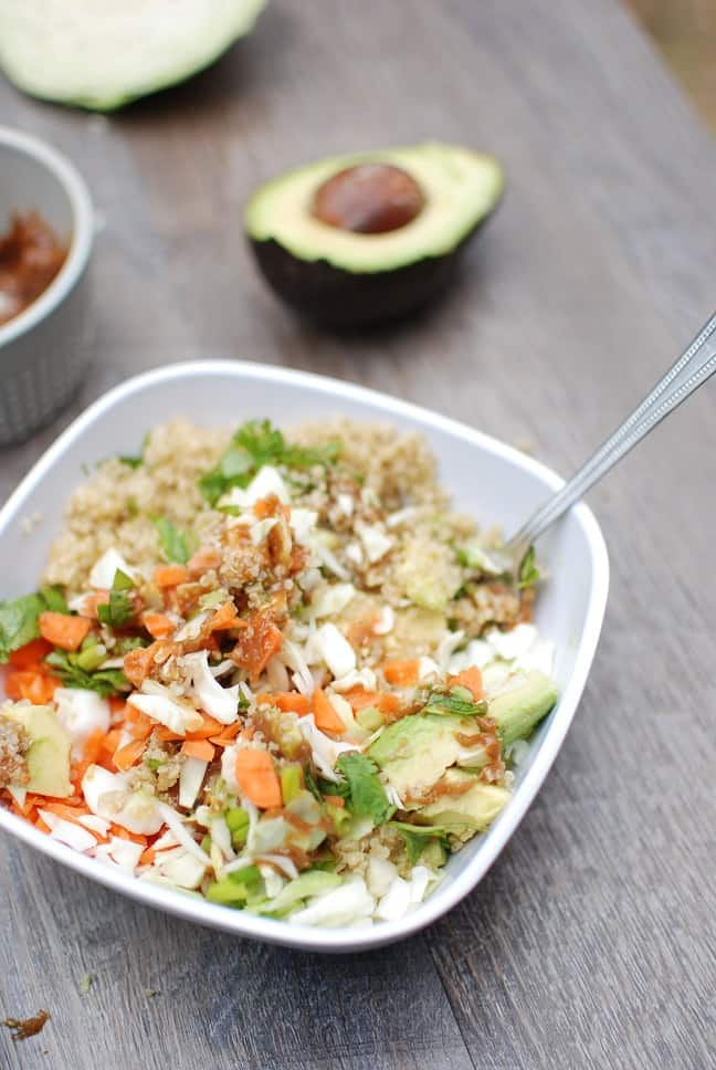 This thai buddah bowl is full of fresh ingredients like quinoa, cabbage and carrots. A peanut sauce pulls this healthy vegetarian recipe all together! Vegan, gluten free, and MSPI variations are included in the post.