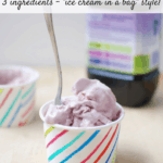 """It's healthy dessert time! This peanut butter and jelly homemade frozen yogurt is made with just 3 ingredients. It's less than 200 calories, packed with 24 grams of protein, and is fun for the whole family when made """"ice cream in a bag"""" style!"""