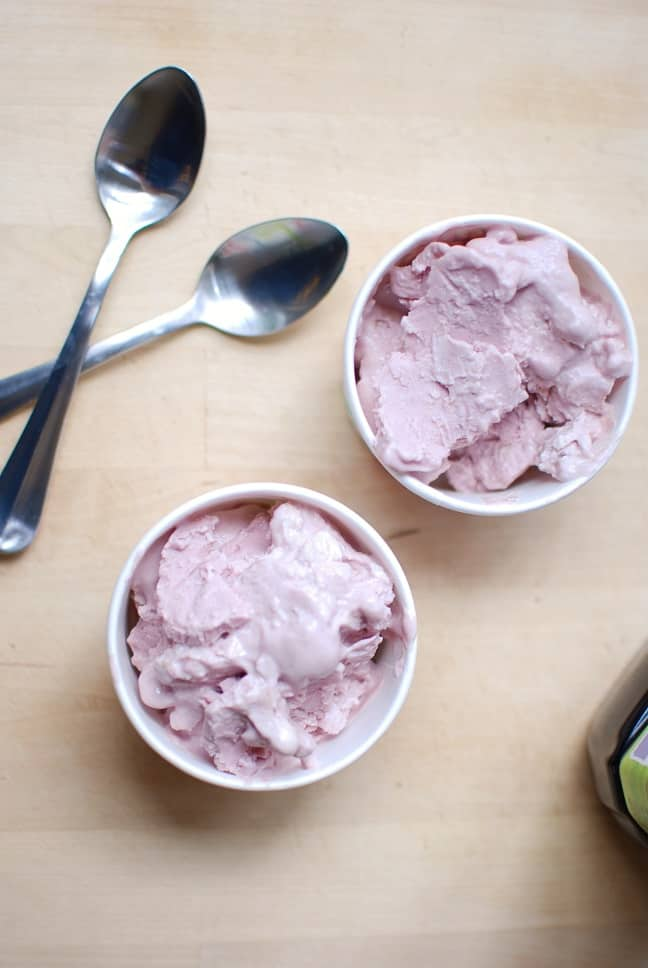 "It's healthy dessert time! This peanut butter and jelly homemade frozen yogurt is made with just 3 ingredients. It's less than 200 calories, packed with 24 grams of protein, and is fun for the whole family when made ""ice cream in a bag"" style!"