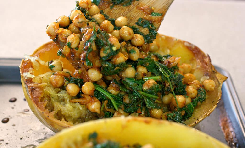 Chickpea kale curry in a spaghetti squash boat? Heck yes! This is such a tasty and healthy spaghetti squash recipe.