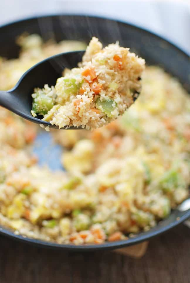 Cauliflower fried rice is a 30 minute meal that tastes like Chinese takeout – but in a healthier at home recipe! With less than 10 ingredients, you'll have this low calorie, low carb dish. Enjoy a small portion for a side dish or a large portion for dinner! | Vegetarian | Dairy Free | Family Friendly
