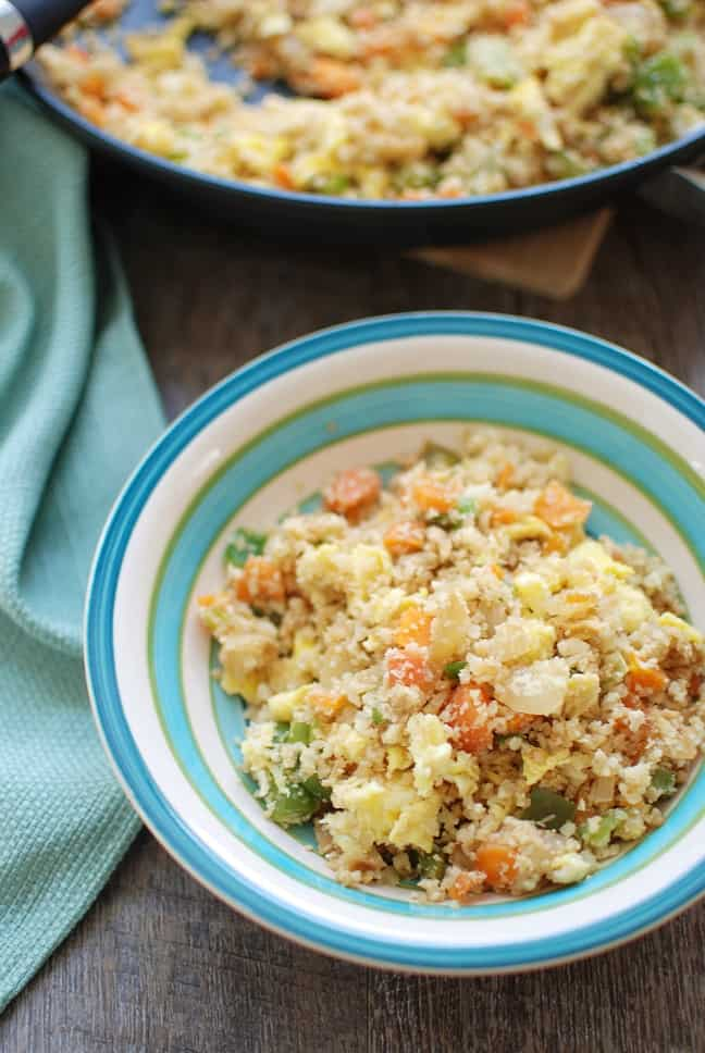 Cauliflower fried rice is a 30 minute meal that tastes like Chinese takeout – but in a healthier at home recipe! With less than 10 ingredients, you'll have this low calorie, low carb dish. Enjoy a small portion for a side dish or a large portion for dinner!   Vegetarian   Dairy Free   Family Friendly