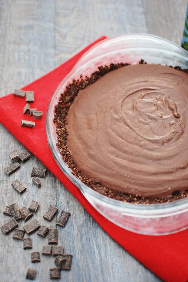 This no bake vegan chocolate pie is one of the yummiest desserts out there! This better-for-you option tastes incredibly rich and decadent, yet clocks in at just 250 calories per slice. Plus it's vegan and gluten free!