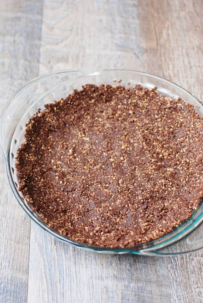 Whip up your next no-bake pie with this healthy pie crust recipe! Made using just 3 ingredients – walnuts, dates, and cocoa powder – so it's gluten free and vegan too.