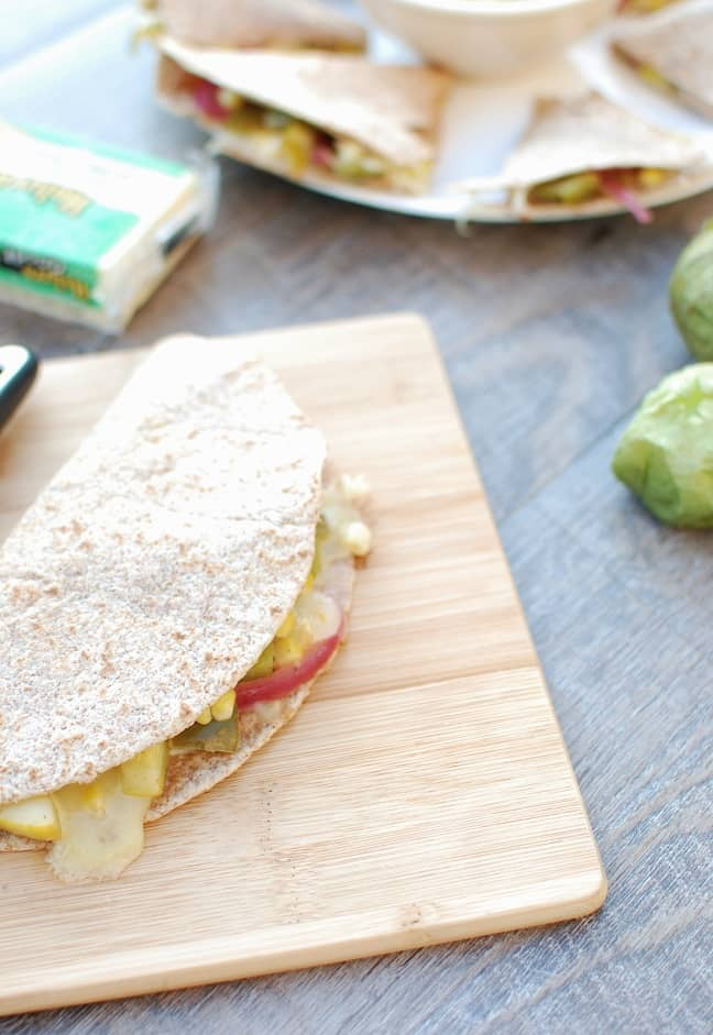 This vegetarian quesadillas with corn, tomatillos, and cheese is perfect for your summer get togethers!