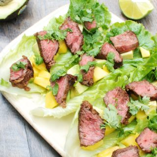 These steak lettuce wraps are fresh and light, yet filling too! Think healthy lettuce wraps made with tasty marinated beef, avocado, and mango.