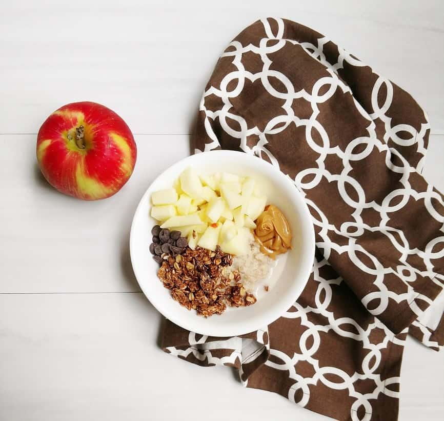 Delicious oatmeal with peanut butter, chocolate granola, and apples!
