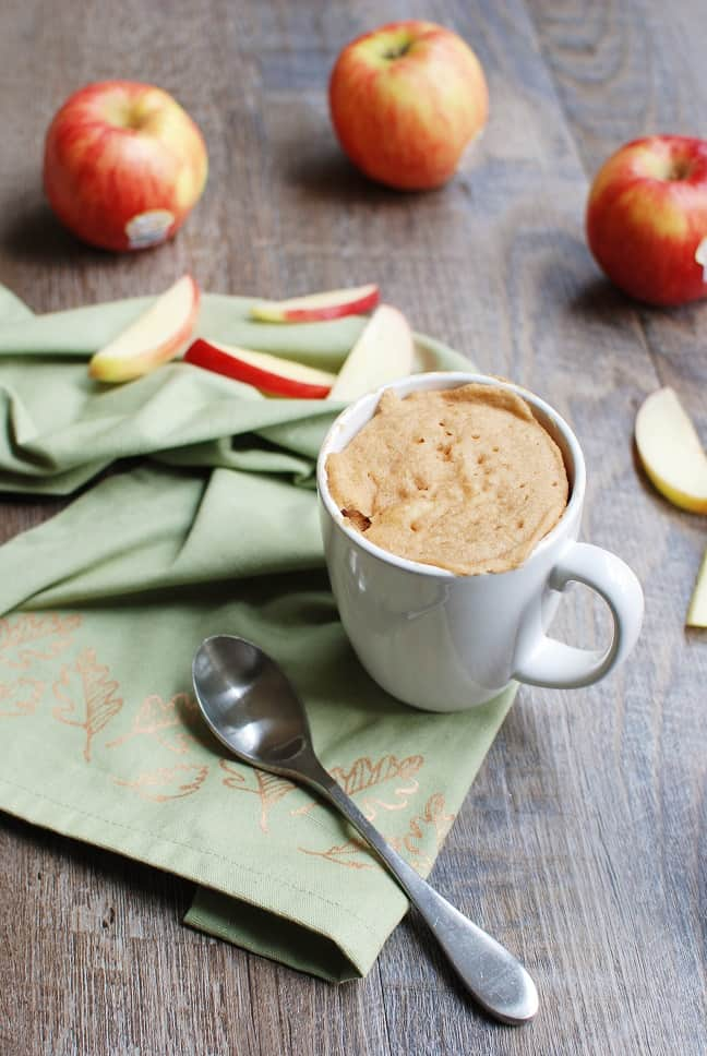 This apple mug cake will soon be your favorite fall snack! Bonus – it's a high protein snack that's great for recovery after a tough run or ride.