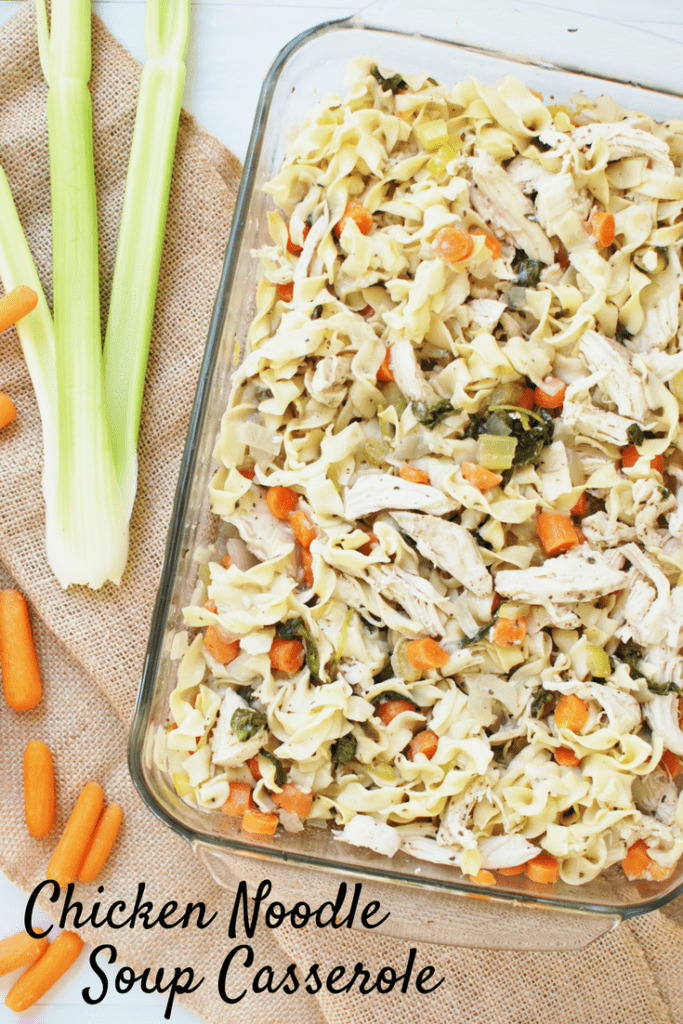 Chicken noodle soup casserole in a dish next to some celery and carrots