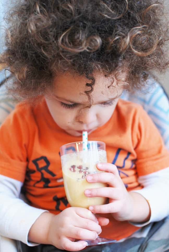 Child drinking a smoothie