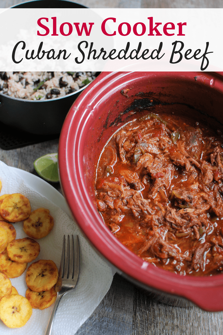 Cuban shredded beef in a slow cooker dish, with a text overlay