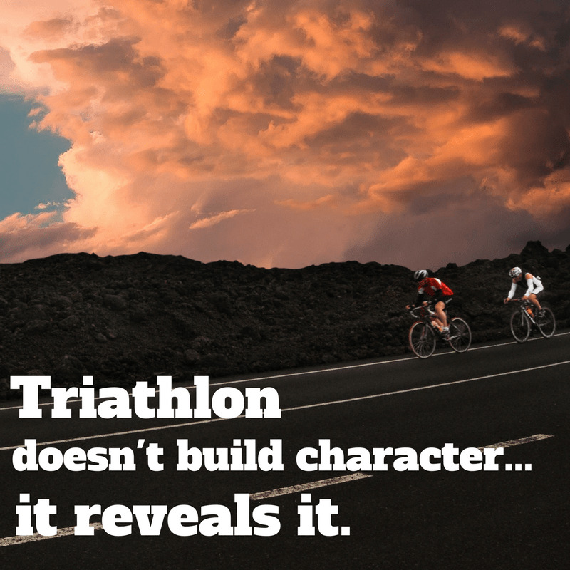 """Cyclists with a text overlay triathlon quote """"triathlon doesn't build character, it reveals it."""""""