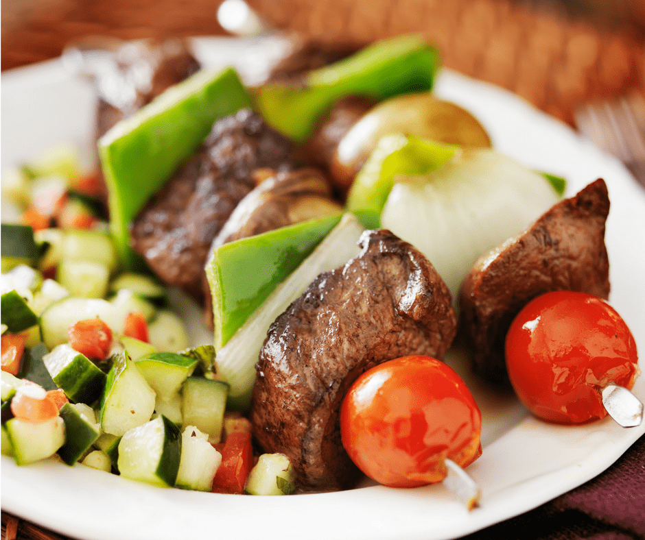beef kebob with tomatoes and zucchini