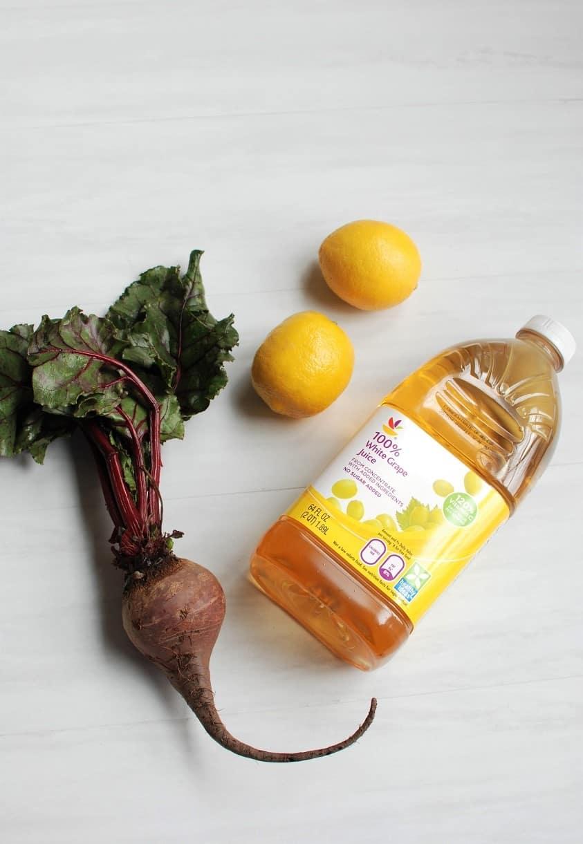 three ingredients for beet lemonade - beets, grape juice, and lemons