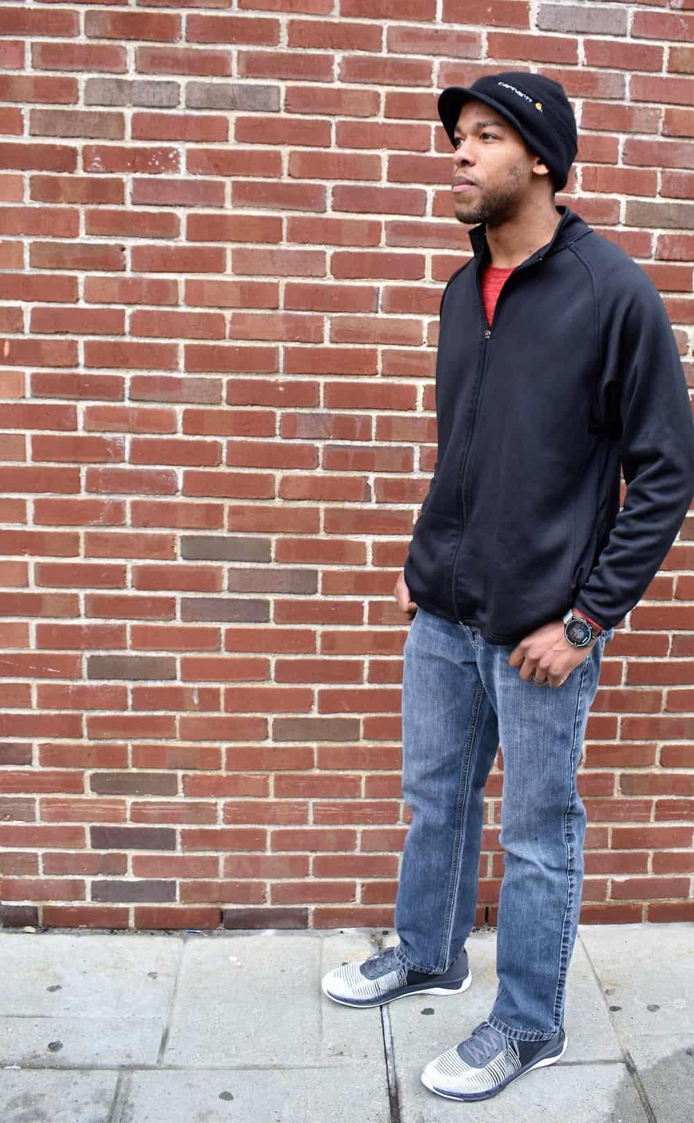 Man wearing a black shirt, jeans, and Reebok Fast Flexweave sneakers