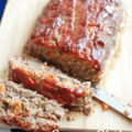 Green chile meatloaf on a cutting board with a text overlay