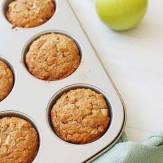 Muffin pan with whole wheat apple muffins