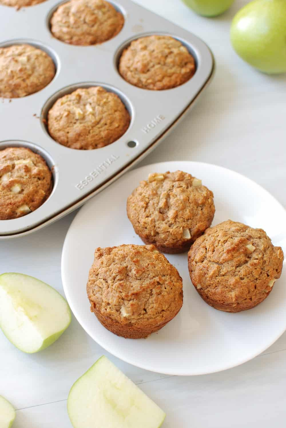 Three whole wheat vegan apple muffins on a plate