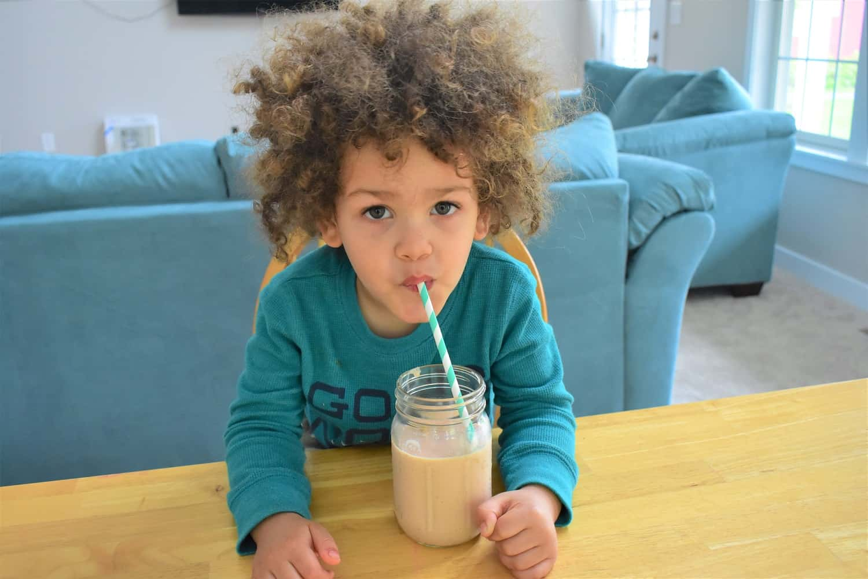 Child drinking a granola smoothie