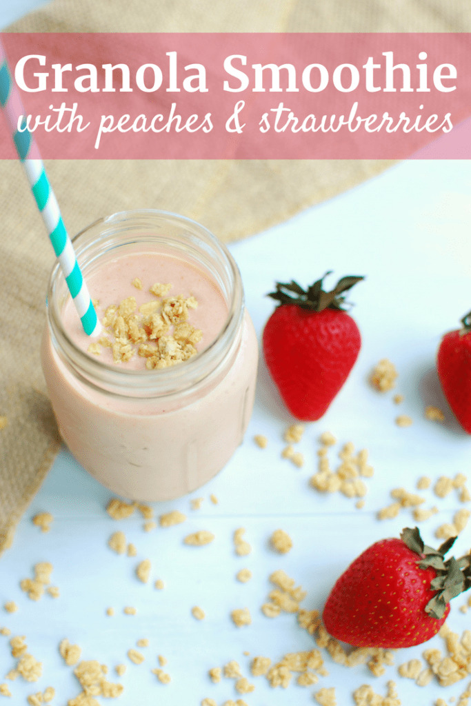 Granola Smoothie in a mason jar next to strawberries
