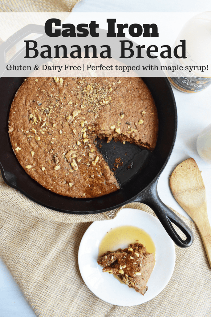 Cast iron banana bread in a skillet next to a plate and spoon