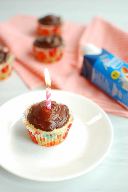 Vegan vanilla cupcake with a birthday candle