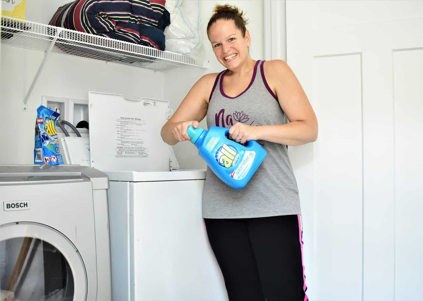 Woman Holding All Detergent to wash workout clothes