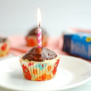 Vegan vanilla cupcake with a birthday candle