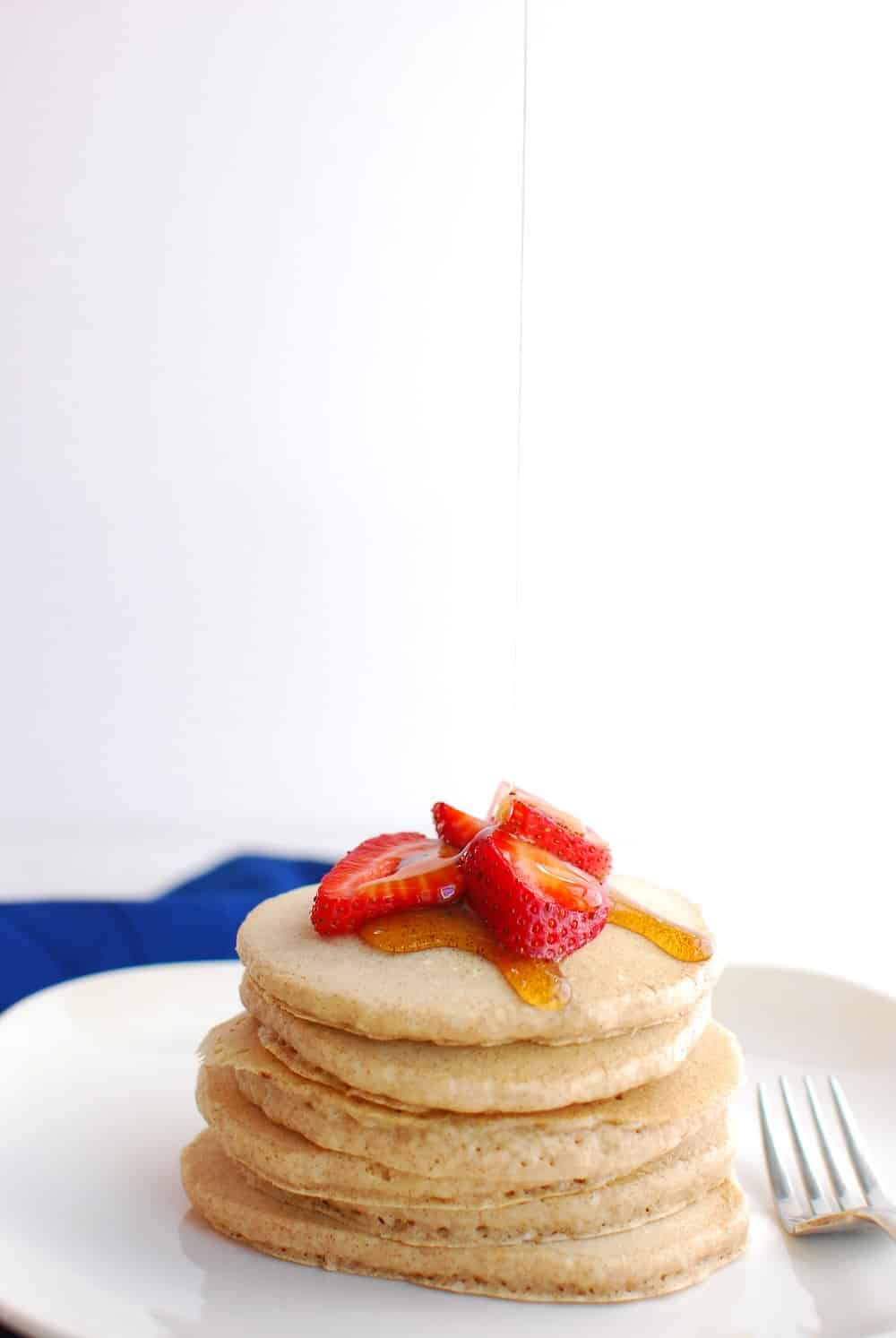 Easy almond milk pancakes dairy free and eggless almond milk pancakes on a plate being drizzled with syrup ccuart Gallery