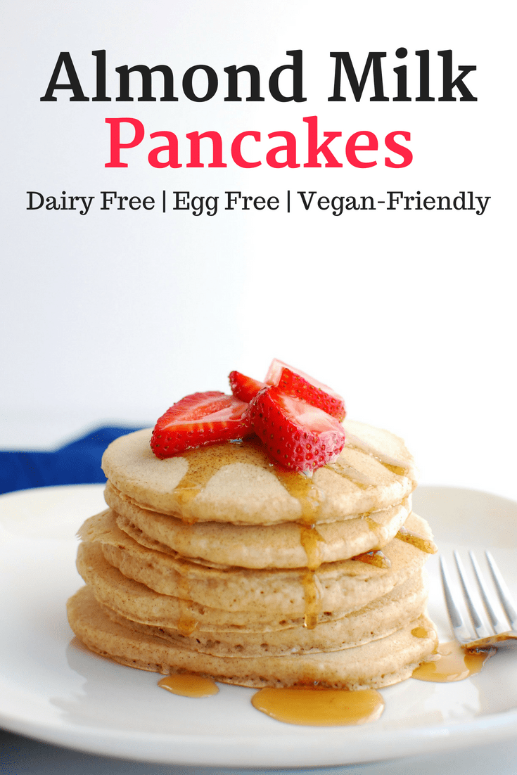 Easy almond milk pancakes dairy free and eggless a stack of almond milk pancakes topped with strawberries and maple syrup ccuart Gallery